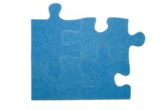 Pieces of a puzzle 2. Four blue pieces of a puzzle with a white background Royalty Free Stock Photography