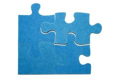 Pieces of a puzzle 3. Four blue pieces of a puzzle with a white background Stock Images