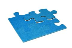 Pieces of a puzzle 4. Four blue pieces of a puzzle with a white background Stock Image