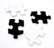 Pieces of a puzzle. Two black and white pieces to a puzzle stock photo