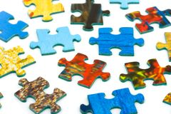 Pieces of puzzle. Isolated on white background Stock Photography