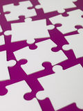 Pieces of a puzzle. Towards purple background Royalty Free Stock Images