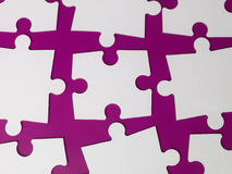 Pieces of a puzzle. Towards purple background Stock Images