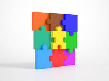 Pieces of a Puzzle building a Wall Royalty Free Stock Images