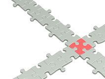 Pieces of a puzzle combined together Stock Photo