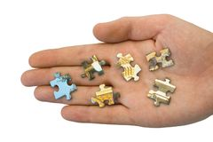 Pieces of puzzle on hand Stock Photo