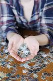 Pieces of puzzle in hands Royalty Free Stock Images