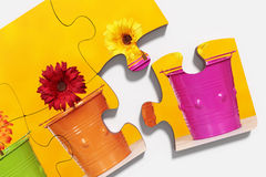 Pieces of puzzle with potted flowers Royalty Free Stock Photo