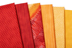 Pieces of quilting fabrics lying on top of each other Royalty Free Stock Photography
