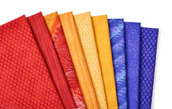 Pieces of quilting fabrics lying on top of each other Stock Photo