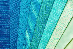 Pieces of quilting fabrics lying on top of each other Royalty Free Stock Images