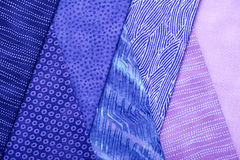 Pieces of quilting fabrics lying on top of each other Royalty Free Stock Photo
