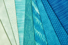 Pieces of quilting fabrics lying on top of each other Royalty Free Stock Photos