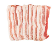 Pieces of raw bacon isolated on white Stock Photos