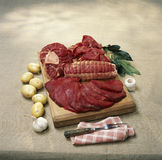 Pieces of raw beef on a chopping board Stock Photo