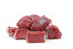 Pieces of raw beef goulash on white Royalty Free Stock Photos