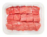 The pieces of raw meat in box isolated on white Royalty Free Stock Photography