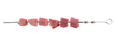 Pieces of raw meat on a skewer Stock Image