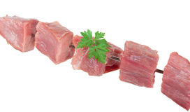 Pieces of raw meat on a skewer Royalty Free Stock Photos