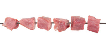 Pieces of raw meat on a skewer Stock Images