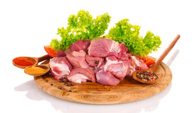 Pieces of raw meat and vegetables Royalty Free Stock Photos