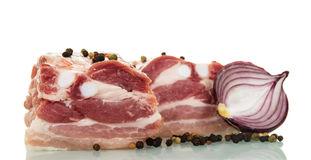 Pieces raw pork brisket, half onion and pepper isolated. stock image
