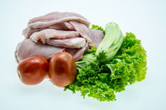 Pieces of raw pork meat and vegetables Stock Images