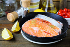Pieces of red fish in the pan, salmon Royalty Free Stock Photo