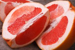 Pieces of red grapefruit closeup Stock Photography