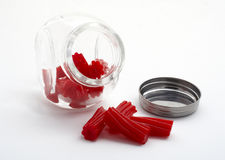 Pieces of red licorice on glass jar Royalty Free Stock Photography
