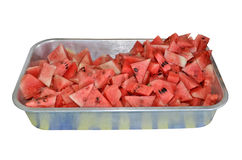 Pieces of red watermelon. Pieces of yummy watermelon in aluminum tray Royalty Free Stock Images