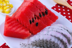 Pieces of refreshing watermelon and dragon fruit Stock Photos