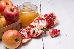 Pieces ripe pomegranate, honey and apple Stock Photography