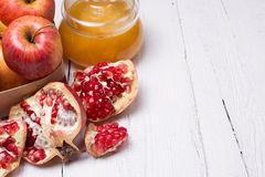 Pieces ripe pomegranate, honey and apple Stock Images