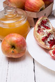 Pieces ripe pomegranate, honey and apple Royalty Free Stock Image
