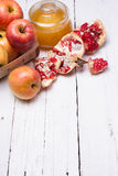 Pieces ripe pomegranate, honey and apple Royalty Free Stock Photo