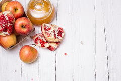 Pieces ripe pomegranate, honey and apple Stock Photo