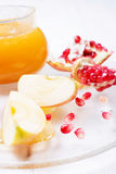 Pieces ripe pomegranate, honey and apple Royalty Free Stock Photos