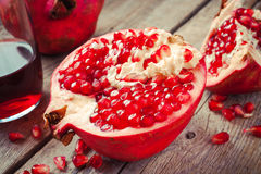 Pieces of ripe pomegranate and juice in glass Royalty Free Stock Photo