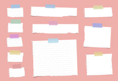 Pieces of ripped white ruled notebook paper are stuck with sticky tape on pink pattern Stock Photos