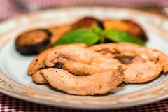 Pieces of roasted chicken and vegetables on plate. Close up plate with pieces of roasted chicken fillet and vegetables, healthy food concept. Selective focus Stock Images