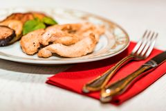 Pieces of roasted chicken and vegetables on plate. Close up plate with pieces of roasted chicken fillet and vegetables, healthy food concept. Selective focus Royalty Free Stock Photos