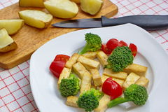 Pieces of roasted tofu served with fresh vegetable and potatoes Royalty Free Stock Photo