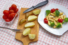 Pieces of roasted tofu served with fresh vegetable and potatoes Stock Photo