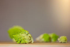 Pieces of Romanesco broccoli on Bamboo Cutting Board Royalty Free Stock Images