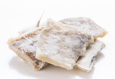 Pieces of salt cod. On white Royalty Free Stock Photo