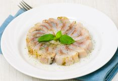 Pieces of salt herring fish. On plate Royalty Free Stock Photography