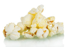 Pieces of salted popcorn  on white Royalty Free Stock Photo
