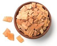 Pieces of sandalwood in the wooden bowl, isolated on white. Pieces of sandalwood in the wooden bowl, isolated on the white Stock Photos