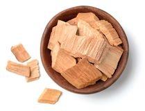 Pieces of sandalwood in the wooden bowl, isolated on white. Pieces of sandalwood in the wooden bowl, isolated on the white Royalty Free Stock Photos